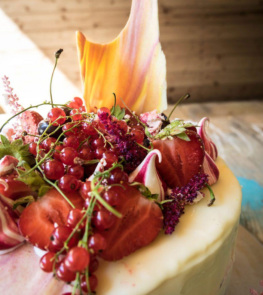 Strawberry vanilla and berry cake detail