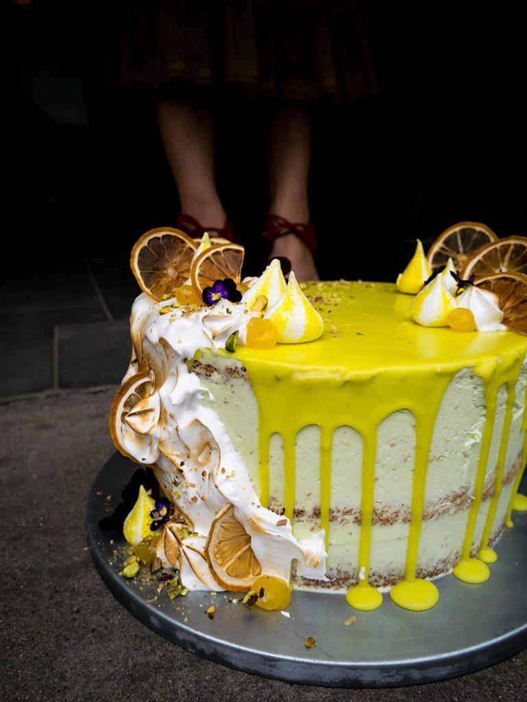 Lemon pistacchio birthday layer drip cake legs