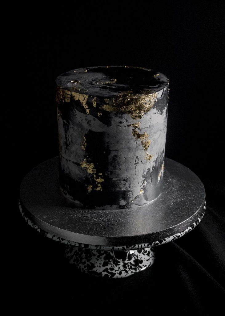Black concrete gold leaf cake top view