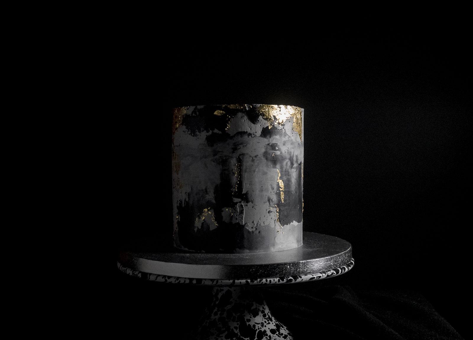 Black concrete gold leaf cake front view