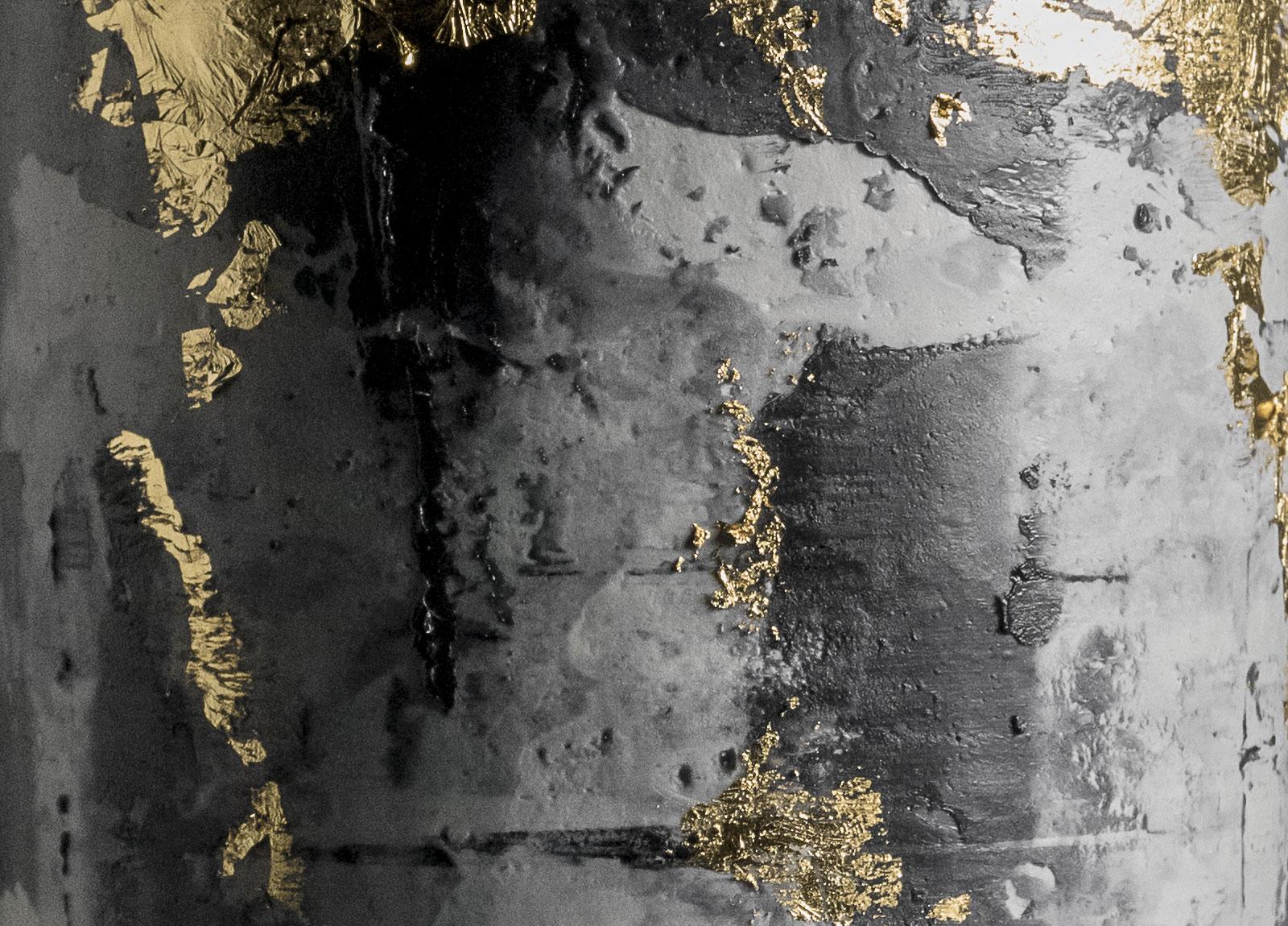 Black concrete gold leaf cake texture