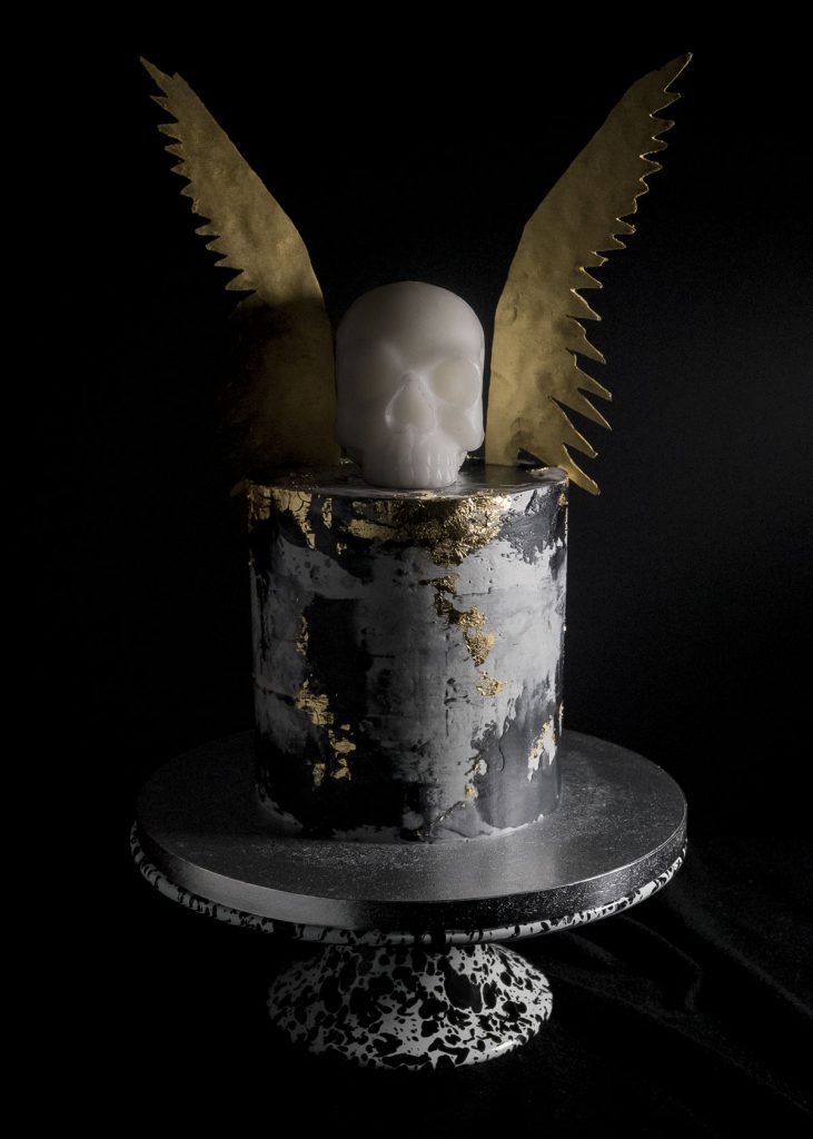 Black concrete gold leaf cake skull and wings